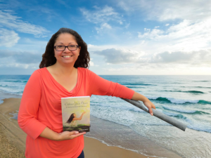 Jennifer holding the book, Embrace Your Power- A Healing Journal of Self-Disovery