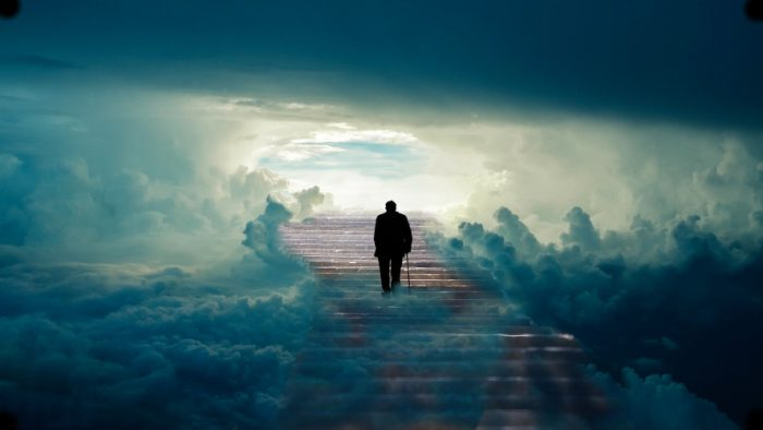 man walking into clear path in clouds
