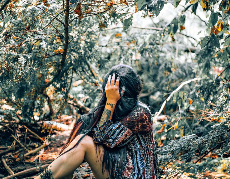 woman heartbroken in forest