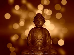 buddha open to receive with lights in background